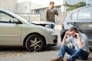 people-on-phone-after-car-accident